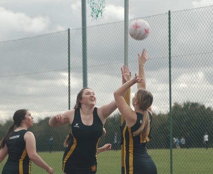 Sixth Form students playing netball