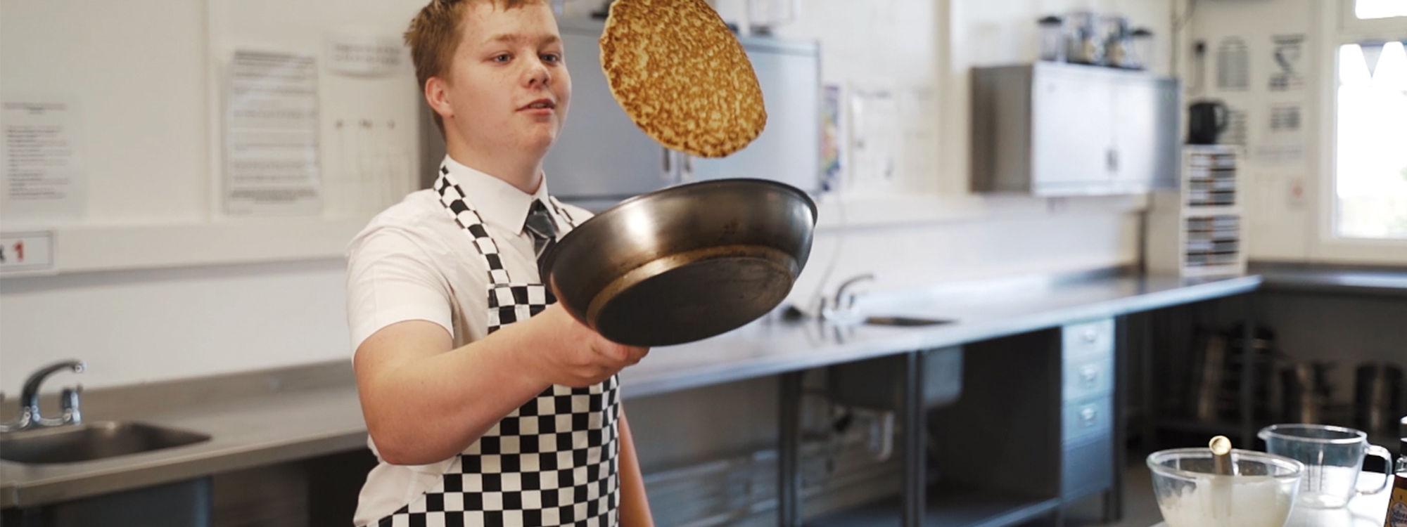 Student cooking pancakes